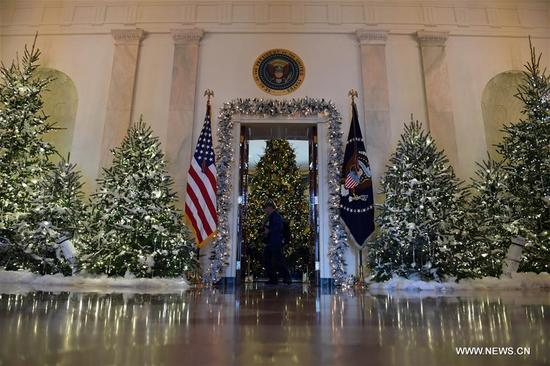 Christmas trees are seen during a media preview of the 2017 holiday decorations at the White House in Washington D.C., the United States, on Nov. 27, 2017. Some 150 volunteers from 29 states spent more than 1,600 hours to finish the decorations including 53 Christmas trees and more than 12,000 ornaments. An estimate of 25,000 visitors are expected to tour the White House for the Christmas holiday. (Xinhua/Yin Bogu)