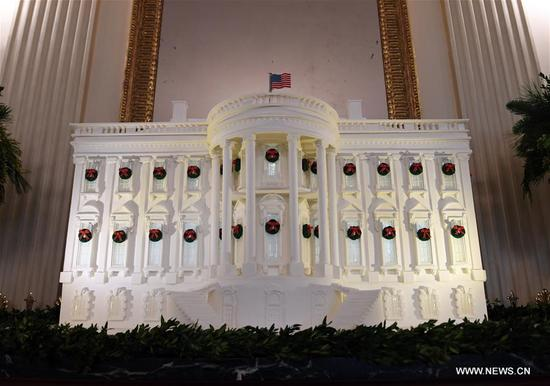 A gingerbread White House is seen in the State Dining Room during a media preview of the 2017 holiday decorations at the White House in Washington D.C., the United States, on Nov. 27, 2017. Some 150 volunteers from 29 states spent more than 1,600 hours to finish the decorations including 53 Christmas trees and more than 12,000 ornaments. An estimate of 25,000 visitors are expected to tour the White House for the Christmas holiday. (Xinhua/Yin Bogu)