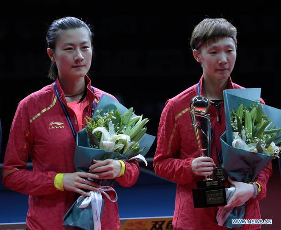 Wang Manyu(R) and Ding Ning of China pose with their trophies during the awardng ceremony for women's singles final at the 2018 ITTF World tour China Open in Shenzhen, south China's Guangdong Province, on June 3, 2018. Wang Manyu claimed the title by defeating Ding Ning with 4-3 in the final. (Xinhua/Wang Dongzhen)