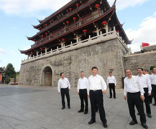 Chinese President Xi Jinping, also general secretary of the Communist Party of China Central Committee and chairman of the Central Military Commission, visits an ancient gate tower and a street lined with ancient memorial archways to check the restoration and protection of cultural relics, the inheritance of intangible cultural heritage and the development of cultural and tourism resources in Chaozhou, south China's Guangdong Province, Oct. 12, 2020. Xi on Monday arrived in Guangdong to begin an inspection tour of the province. (Xinhua/Wang Ye)