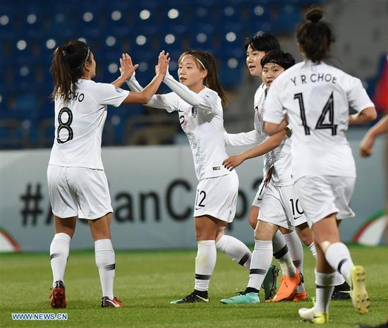 Jang Sel-Gi (2nd L) celebrates scoring with teammate during the fifth place match between South Korea and the Philippines at the 2018 AFC Women's Asian Cup in Amman, Jordan, on April 16, 2018. (Xinhua/He Canling)