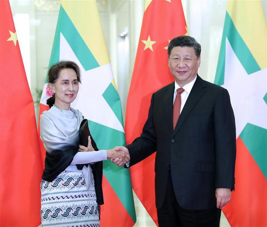 Chinese President Xi Jinping (R) meets with Myanmar's State Counselor Aung San Suu Kyi ahead of the Second Belt and Road Forum for International Cooperation in Beijing, capital of China, April 24, 2019. (Xinhua/Wang Ye)