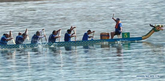 People take part in a dragon boat race to celebrate the Dragon Boat Festival on Xujiachong bay in Zigui County, central China's Hubei Province, on June 6, 2019. The Dragon Boat Festival falls on the fifth day of the fifth month of the Chinese lunar calendar, or June 7 this year. (Xinhua/Wang Gang)