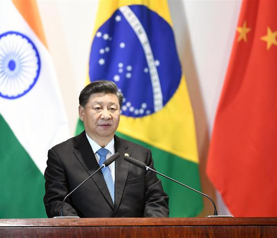 Chinese President Xi Jinping speaks during the BRICS leaders' dialogue with the BRICS Business Council and the New Development Bank in Brasilia, Brazil, Nov. 14, 2019. The BRICS leaders' dialogue with the BRICS Business Council and the New Development Bank was held on Thursday in Brasilia. Chinese President Xi Jinping, Brazilian President Jair Bolsonaro, Russian President Vladimir Putin, Indian Prime Minister Narendra Modi and South African President Cyril Ramaphosa attended the dialogue. (Xinhua/Zhang Ling)