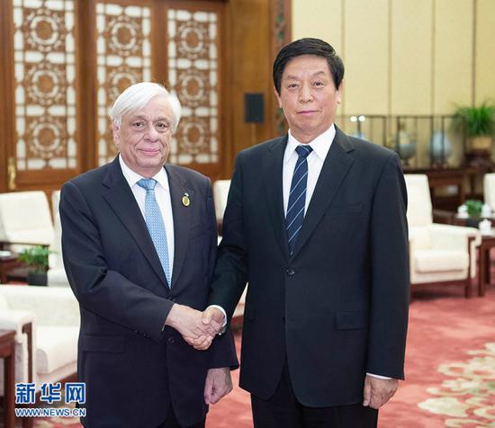 China's top legislator Li Zhanshu meets with Greek President Prokopis Pavlopoulos in Beijing on May 13, 2019. [Photo: Xinhua]