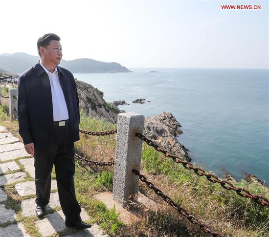 Chinese President Xi Jinping, also general secretary of the Communist Party of China Central Committee and chairman of the Central Military Commission, visits a fort relic site on Liugong Island during an inspection tour in Weihai, east China's Shandong Province, June 12, 2018. (Xinhua/Xie Huanchi)