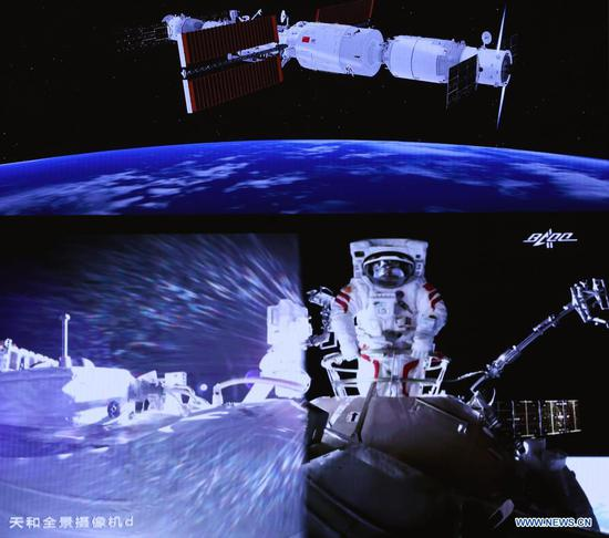 Screen image taken at Beijing Aerospace Control Center on July 4, 2021 shows Chinese astronaut Liu Boming conducting extravehicular activities (EVAs) out of the space station core module Tianhe. Chinese astronauts Liu Boming and Tang Hongbo had both slipped out of the space station core module Tianhe by 11:02 a.m. (Beijing Time) on Sunday, starting EVAs, according to the China Manned Space Agency (CMSA). Donning new-generation homemade EMU (extravehicular mobility unit) spacesuits Feitian, meaning flying to space, the two astronauts have completed installing the foot restraints and extravehicular working platform on the mechanical arm, the CMSA said. They will continue to work together to install other relevant extravehicular equipment with the aid of the mechanical arm, it said. Astronaut Nie Haisheng has been staying inside Tianhe in cooperation with Liu and Tang for their EVAs. (Xinhua/Jin Liwang)