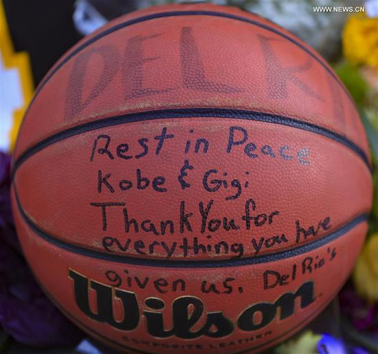 Photo taken on Jan. 29, 2020 shows a basketball near the Staples Center to pay respect to Kobe Bryant, in Los Angeles, California, the United States. Retired NBA star Kobe Bryant was one of nine people killed in a helicopter crash amid a foggy condition in the hills above Calabasas, southern California, on Jan. 26, 2020. (Xinhua/Li Ying)