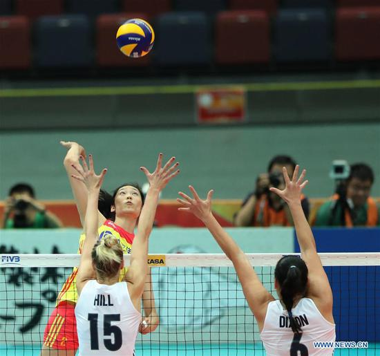 Zhu Ting (top) of China spikes during the Pool F match against the United States at the 2018 Volleyball Women's World Championship in Osaka, Japan, Oct. 10, 2018. China won 3-0. (Xinhua/Du Xiaoyi)