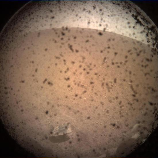 In this image released by NASA/JPL-Caltech on November 26, 2018, debris is seen on the lens in the first image from NASA's InSight lander after it touched down on the surface of Mars.