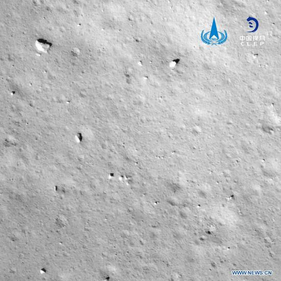 Photo provided by the China National Space Administration (CNSA) shows an image taken by camera aboard Chang'e-5 spacecraft during its landing process. China's Chang'e-5 spacecraft successfully landed on the near side of the moon late Tuesday and sent back images, the China National Space Administration (CNSA) announced. At 11:11 p.m., the spacecraft landed at the preselected landing area near 51.8 degrees west longitude and 43.1 degrees north latitude, said the CNSA. During the landing process, the cameras aboard the lander took images of the landing area, said the CNSA. (CNSA/Handout via Xinhua)