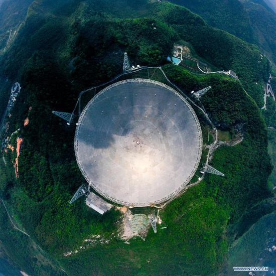 A staff member works at the control room of China's Five-hundred-meter Aperture Spherical radio Telescope (FAST) in southwest China's Guizhou Province, March 27, 2021. FAST has identified over 300 pulsars so far. Located in a naturally deep and round karst depression in southwest China's Guizhou Province, it officially began operating on Jan. 11, 2020. (Xinhua/Ou Dongqu)