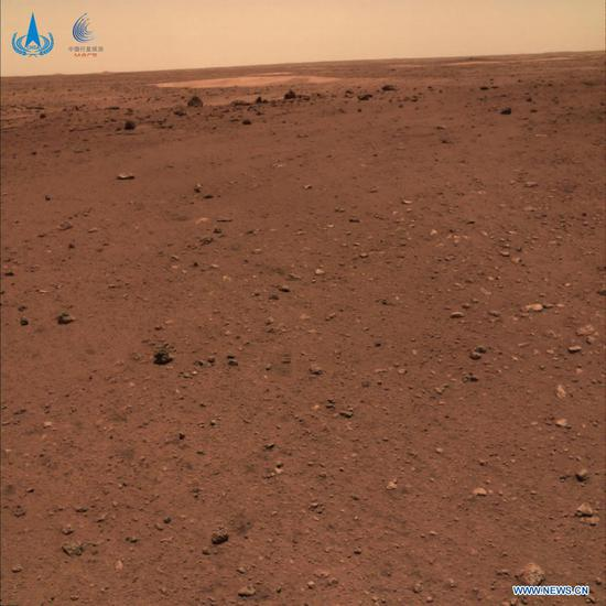 Photo released on June 11, 2021 by the China National Space Administration (CNSA) shows the Martian landscape. The China National Space Administration Friday released new images taken by the country's first Mars rover Zhurong, showing national flag on the red planet. The images were unveiled at a ceremony in Beijing, signifying a complete success of China's first mars exploration mission. The images include the landing site panorama, Martian landscape and a selfie of the rover with the landing platform. (CNSA/Handout via Xinhua)