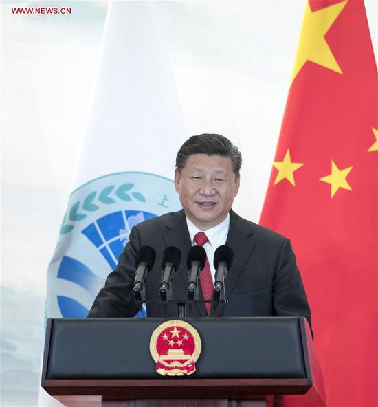 Chinese President Xi Jinping addresses a banquet held for guests attending the 18th Shanghai Cooperation Organization (SCO) summit in Qingdao, east China's Shandong Province, June 9, 2018. (Xinhua/Xie Huanchi)