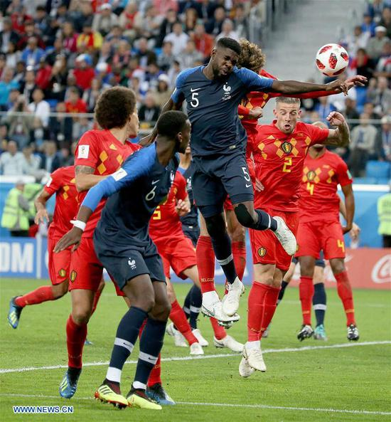 Samuel Umtiti (top) of France scores with a header during the 2018 FIFA World Cup semi-final match between France and Belgium in Saint Petersburg, Russia, July 10, 2018. (Xinhua/Li Ming)
