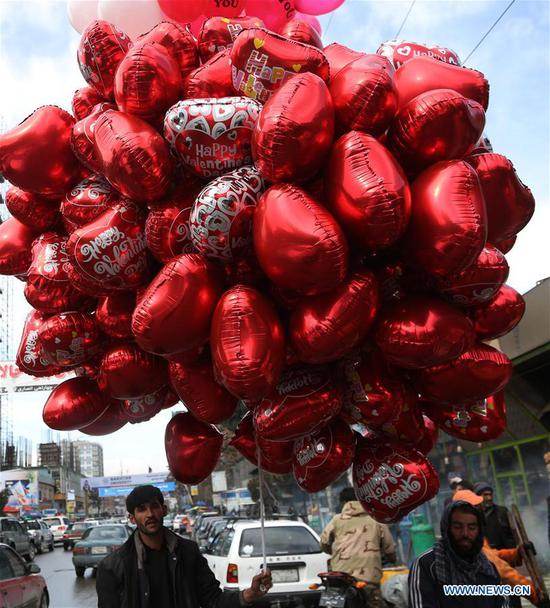 An Afghan man sells heart-shaped balloons ahead of the Valentine's Day in Kabul, capital of Afghanistan, Feb. 13, 2020. (Xinhua/Rahmatullah Alizadah)
