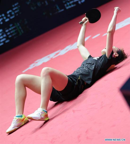 Wang Manyu of China celebrates during the women's singles final match against Ding Ning of China at the 2018 ITTF World tour China Open in Shenzhen, south China's Guangdong Province, on June 3, 2018. Wang Manyu claimed the title by defeating Ding Ning with 4-3 in the final. (Xinhua/Wang Dongzhen)