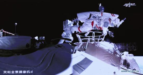 Screen image taken at Beijing Aerospace Control Center on July 4, 2021 shows Chinese astronaut Liu Boming slipping out of the space station core module Tianhe. Chinese astronauts Liu Boming and Tang Hongbo had both slipped out of the space station core module Tianhe by 11:02 a.m. (Beijing Time) on Sunday, starting extravehicular activities (EVAs), according to the China Manned Space Agency (CMSA). Donning new-generation homemade EMU (extravehicular mobility unit) spacesuits Feitian, meaning flying to space, the two astronauts have completed installing the foot restraints and extravehicular working platform on the mechanical arm, the CMSA said. They will continue to work together to install other relevant extravehicular equipment with the aid of the mechanical arm, it said. Astronaut Nie Haisheng has been staying inside Tianhe in cooperation with Liu and Tang for their EVAs. (Xinhua/Jin Liwang)