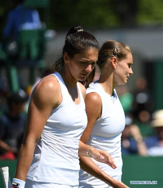 Margarita Gasparyan (Front)/Alexandra Panov react during the women's doubles first round match between Zhang Shuai of China/Samantha Stosur of Australia and Margarita Gasparyan/Alexandra Panova of Russia at the 2019 Wimbledon Tennis Championships in London, Britain, July 4, 2019. (Xinhua/Lu Yang)