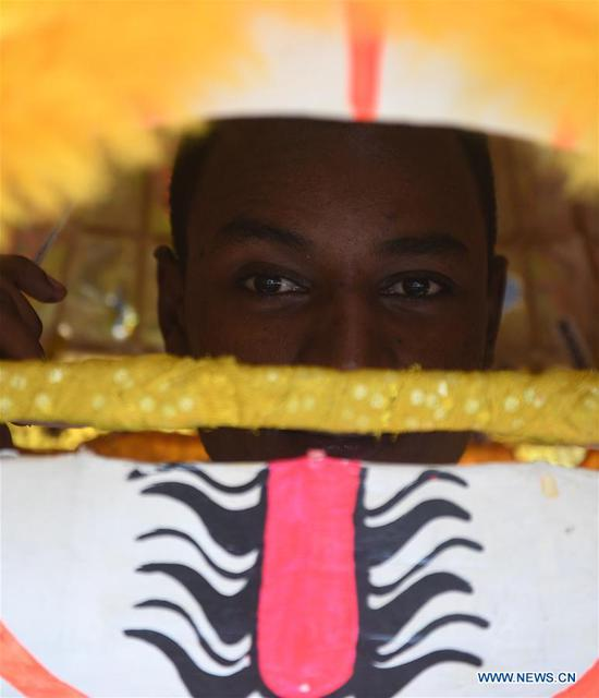 An Ethiopian worker of ANTEX Fashion Group learns lion dancing in Qianyuan Township of Deqing County, east China's Zhejiang Province, Aug. 30, 2018. In 2017, Zhejiang's ANTEX Fashion Group set a branch in Ethiopia. To build a better team, the Ethiopian branch has sent 93 Ethiopian workers to China for six-month training. Besides learning production skills, these workers also learnt Chinese language, calligraphy and martial art in spare time.