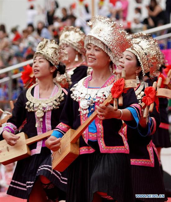 People celebrate the Longji Terrace Culture Festival in Longsheng County, south China's Guangxi Zhuang Autonomous Region, June 17, 2019. People of various ethnic groups gathered here to showcase their culture during the festival. (Xinhua/Huang Yongdan)
