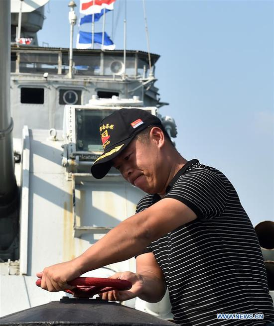 Yang Shuangfeng conducts maintenance on DDG-163 Nanchang, a decommissioned destroyer ship which is now a military theme park, in Nanchang, east China's Jiangxi Province, Aug. 8, 2019. After it was decommissioned in September 2016, DDG-163 Nanchang, a Type 051 guided-missile destroyer of the People's Liberation Army (PLA) Navy, remains a tourist attraction in Nanchang, the city after which it was named. To navy veteran Yang Shuangfeng, the last Chief Engineer on DDG-163, the ship means more like a comrade than a mere tourist destination. When DDG-163 went out of service, Yang had realized that it was hard for him to just give up on this