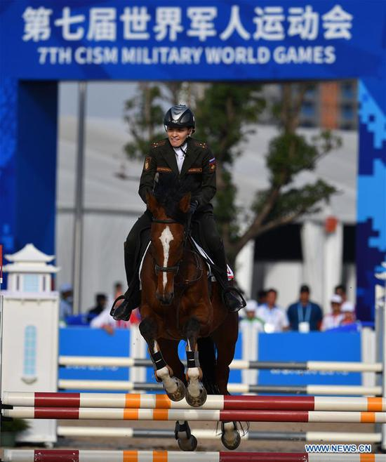Russia's Ekaterina Khuraskina competes during the women's individual riding final of modern pentathlon at the 7th CISM Military World Games in Wuhan, capital of central China's Hubei Province, Oct. 24, 2019. (Xinhua/Li Ga)