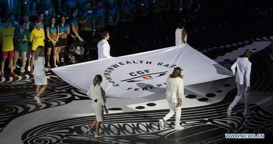 The Commonwealth Games Federation flag is carried during the opening ceremony of the 2018 Gold Coast Commonwealth Games at the Carrara Stadium in the Gold Coast, Australia, April 4, 2018. (Xinhua/Zhu Hongye)