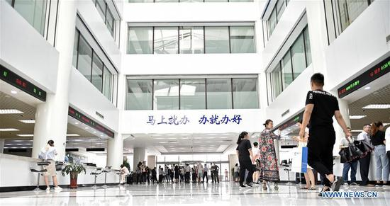 Photo taken on June 24, 2019 shows the government affairs hall of Dalian Area of China (Liaoning) Pilot Free Trade Zone in Dalian, northeast China's Liaoning Province. The 2019 Summer Davos Forum is held from July 1-3 in northeast China's coastal city of Dalian. Established by the World Economic Forum in 2007, the forum is held annually in China, alternating between the two port cities of Dalian and Tianjin. Summer Davos helped Dalian reshape the landscape of regional economy and strengthen the port's trade with other markets. Dalian has become an international city and a showpiece of China's reform and opening up. (Xinhua/Yao Jianfeng)