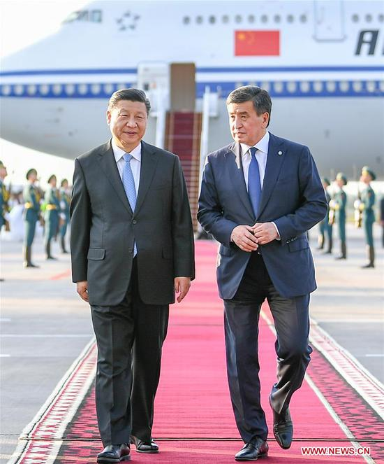 Chinese President Xi Jinping has a cordial talk with his Kyrgyz counterpart Sooronbay Jeenbekov upon his arrival in Bishkek, Kyrgyzstan, June 12, 2019. Xi arrived here Wednesday for a state visit to Kyrgyzstan and the 19th Shanghai Cooperation Organization (SCO) summit. (Xinhua/Xie Huanchi)