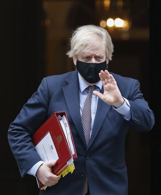 British Prime Minister Boris Johnson leaves 10 Downing Street to the House of Commons in London, Britain, on March 3, 2021. (Xinhua/Han Yan)