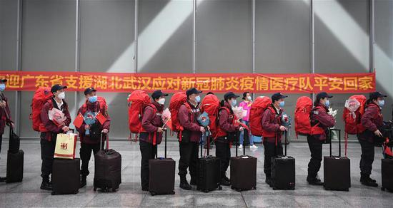 Medics supporting virus-hit Hubei Province arrive at Guangzhou South Railway Station in Guangzhou, south China's Guangdong Province, March 20, 2020. Medical assistance teams from Guangzhou, which consists of over 1,000 members, left Hubei Province in batches as the epidemic outbreak in the hard-hit province has been subdued. (Xinhua/Deng Hua)