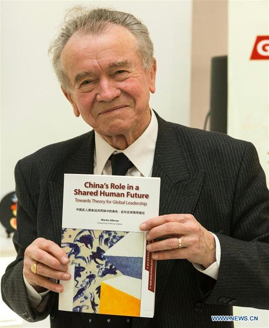 Photo taken on April 10, 2018 shows Professor Martin Albrow holding his book, China's Role in a Shared Human Future, at the 2018 London Book Fair in London, Britain. The English edition of Prof. Martin Albrow's book, China's Role in a Shared Human Future, was launched Tuesday at the 2018 London Book Fair. (Xinhua/Ray Tang)