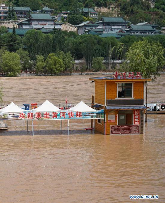Photo taken on June 27, 2020 shows a temporarily closed cableway dock on the Yellow River in Lanzhou, northwest China's Gansu Province. Water level of the Lanzhou section of the Yellow River has risen due to continous rainfall and operations of reservoirs in the upper reaches. Some tourist attractions and facilities along the river have been temporarily closed. (Photo by Lang Bingbing/Xinhua)