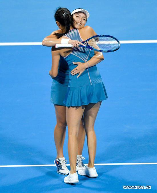 Latisha Chan (rear) and Hao-Ching Chan of Chinese Taipei celebrate after winning the doubles final against Demi Schuurs of the Nederlands and Anna-Lena Groenefeld of Germany at the 2019 WTA Qatar Open in Doha, Qatar, Feb. 16, 2019. Hao-Ching Chan and Latisha Chan won 2-1 and claimed the title. (Xinhua/Nikku)