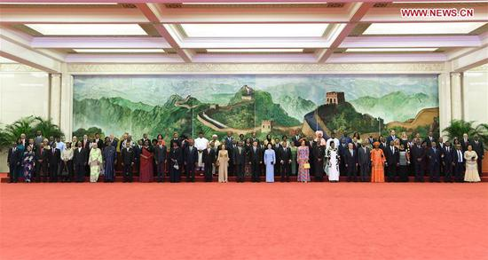 Chinese President Xi Jinping and his wife Peng Liyuan, together with foreign leaders and their spouses attending the Beijing Summit of the Forum on China-Africa Cooperation (FOCAC), pose for a group photo before a welcoming banquet held at the Great Hall of the People in Beijing, capital of China, Sept. 3, 2018. (Xinhua/Zhang Ling)