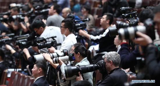 Journalists work during the third plenary meeting of the second session of the 13th National Committee of the Chinese People's Political Consultative Conference (CPPCC) at the Great Hall of the People in Beijing, capital of China, March 10, 2019. (Xinhua/Liu Weibing)