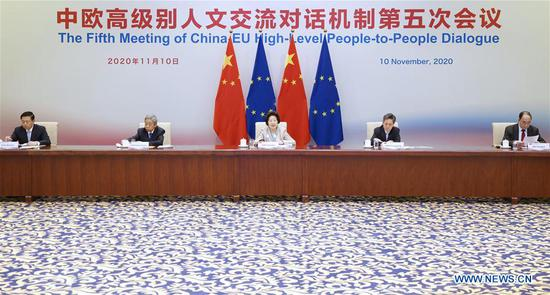 The fifth meeting of the China-EU high-level people-to-people dialogue is held via video link on Nov. 10, 2020. Chinese Vice Premier Sun Chunlan and Mariya Gabriel, European Commissioner for Innovation, Research, Culture, Education and Youth, attended the meeting. (Xinhua/Liu Bin)