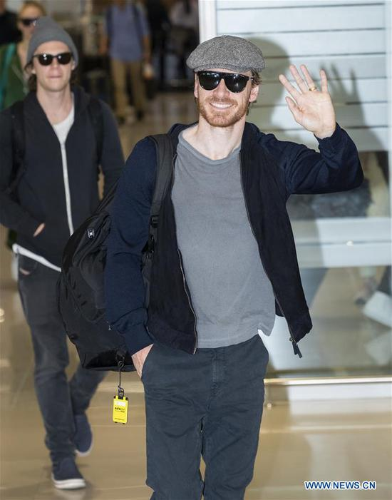 Actor Michael Fassbender (R) arrives at Incheon International Airport to promote the film