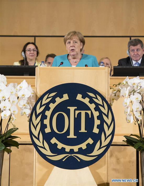 German Chancellor Angela Merkel delivers a speech during the 108th session of the International Labour Conference in Geneva, Switzerland, June 11, 2019. Angela Merkel on Tuesday said that the world must work further to improve working conditions and turn economic growth into social progress. (Xinhua/Xu Jinquan)