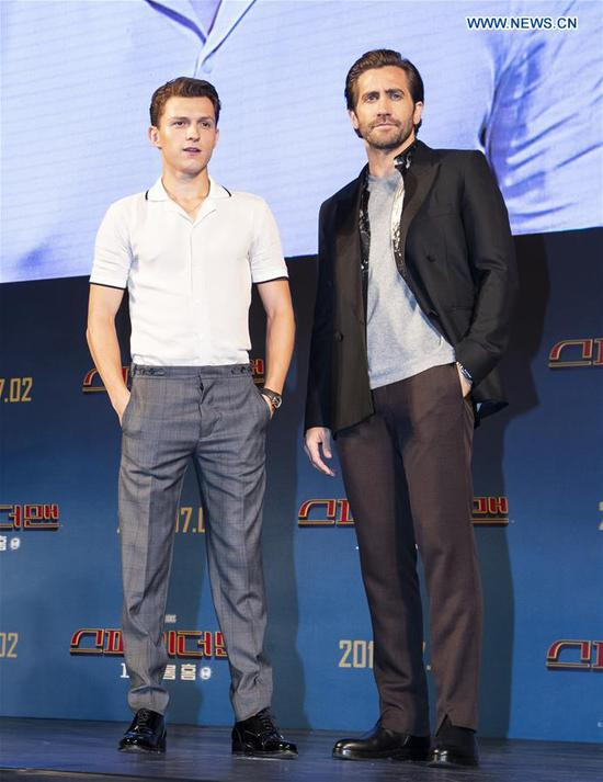 Actors Tom Holland (L) and Jake Gyllenhaal attend a press conference of the film