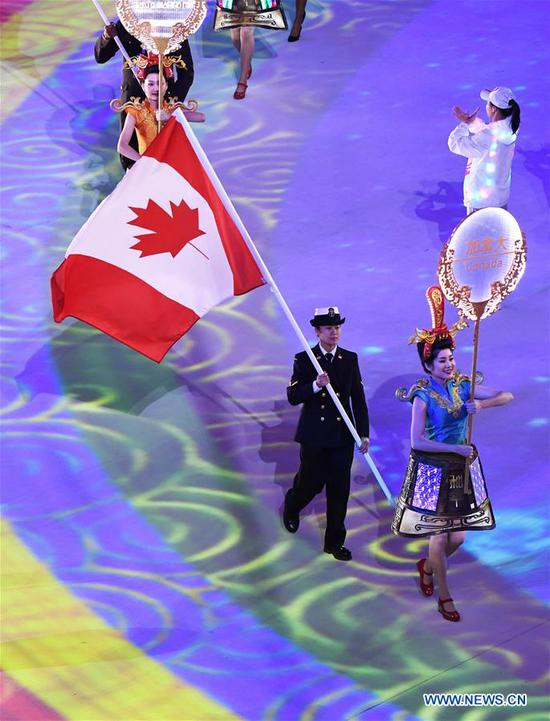 Flag bearer of Canada walks into the stadium during the closing ceremony of the 7th CISM Military World Games in Wuhan, capital of central China's Hubei Province, Oct. 27, 2019. (Xinhua/Wan Xiang)