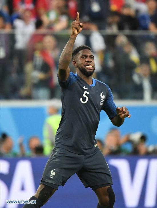 Samuel Umtiti of France celebrates scoring during the 2018 FIFA World Cup semi-final match between France and Belgium in Saint Petersburg, Russia, July 10, 2018. (Xinhua/Li Ga)
