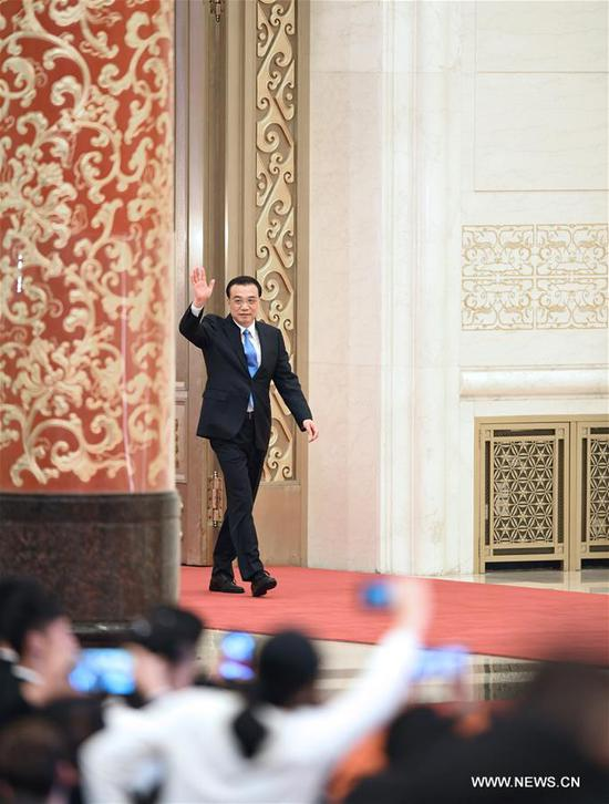Chinese Premier Li Keqiang arrives for a press conference after the conclusion of the second session of the 13th National People's Congress (NPC) at the Great Hall of the People in Beijing, capital of China, March 15, 2019. (Xinhua/Chen Yehua)