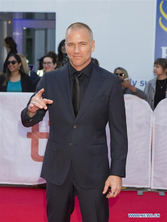 Actor Sean Carrigan poses for photos before the international premiere of the film