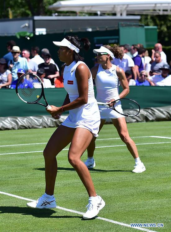 Zhang Shuai/Samantha Stosur (R) return a shot during the women's doubles first round match between Zhang Shuai of China/Samantha Stosur of Australia and Margarita Gasparyan/Alexandra Panova of Russia at the 2019 Wimbledon Tennis Championships in London, Britain, July 4, 2019. (Xinhua/Lu Yang)