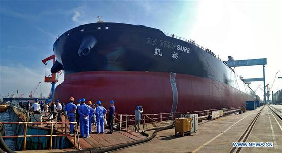 A cargo ship is seen at Dalian Shipbuilding Industry Co., Ltd. in Dalian, northeast China's Liaoning Province, June 25, 2019. The 2019 Summer Davos Forum is held from July 1-3 in northeast China's coastal city of Dalian. Established by the World Economic Forum in 2007, the forum is held annually in China, alternating between the two port cities of Dalian and Tianjin. Summer Davos helped Dalian reshape the landscape of regional economy and strengthen the port's trade with other markets. Dalian has become an international city and a showpiece of China's reform and opening up. (Xinhua/Yao Jianfeng)