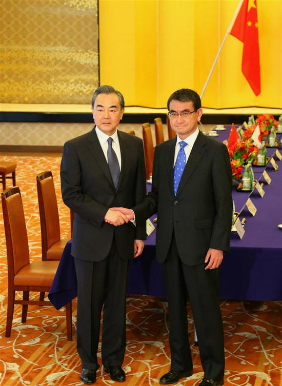 Chinese State Councilor and Foreign Minister Wang Yi (L) meets with Japanese Foreign Minister Taro Kono in Tokyo, Japan, on April 15, 2018. China and Japan agreed to further consolidate the momentum of improvement in bilateral ties during a meeting between Chinese State Councilor and Foreign Minister Wang Yi and Japanese Foreign Minister Taro Kono here on Sunday. (Xinhua/Lv Shaowei)