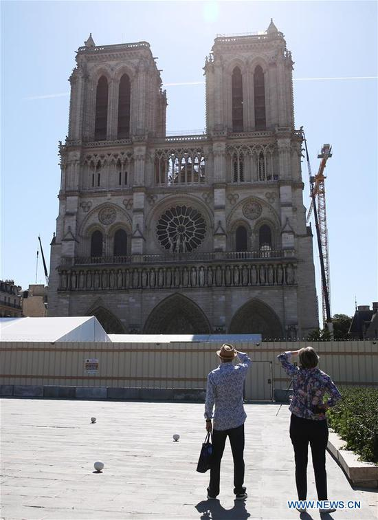 People visit the open space in front of the Notre-Dame Cathedral in Paris, France, June 2, 2020. The Parvis Notre-Dame was reopened to the public from May 31 after more than one year's close because of the huge fire on April 15, 2019. (Xinhua/Gao Jing)