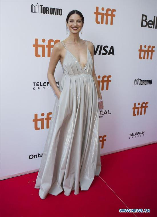 Actress Caitriona Balfe poses for photos before the international premiere of the film